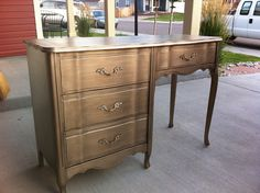 Relove: Tarnished French Provincial Desk {sold}After priming she used Martha Stewart's metallic paint in Vintage Gold and a glaze in Black Coffee over that. She sealed it with Mini-wax polycrylic.