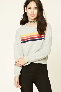 A heathered French terry knit sweatshirt featuring embroidered multicolored stripes, a round neckline, long sleeves, and a ribbed trim.