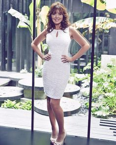 Carol Vorderman looks adorable in a white dress