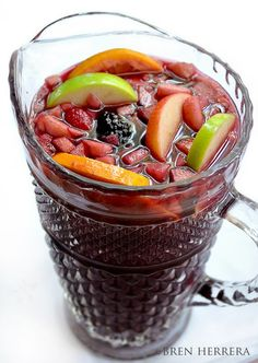 Red Sangria ~ 1 3/4 bottle of Merlot, 8 oz. ginger ale, 10 oz. fresh squeezed orange juice, 4-6 oz. Triple Sec, 1.5 orange, peeled and sliced (divide), 1 gala apple, diced, 1 of Granny Smith apple, sliced, 5 heaping tsps. refined sugar