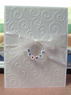 White Embossed Wedding Invitation/Thank You Card...with alphabet beads.