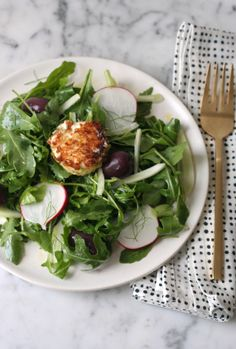 Salad with pistachio crusted goat cheese. Get the recipe via @PureWow