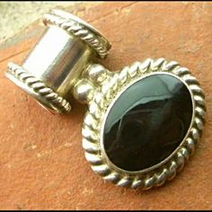 """VINTAGE Signed Mexican Silver & Onyx Slide Pendant This is a beautiful large oval Onyx set in a sterling silver setting with rope detail. Signed Mexico 925 and I believe an H with a circle around it. Good condition with minor wear to the face of the stone (close up in pic 2) and scratches to the back of the pendant (pic 3). It measures 1 1/2"""" tall by 1""""wide and weighs a hefty 1t grams. Beautiful and classy piece. Vintage Jewelry Necklaces"""
