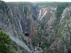 Wollomombi Falls (pronounced 'walla mom bee'), from an Aboriginal word, are located in the Oxley Wild Rivers National Park, 40 km due east of Armidale, New South Wales and 1 km off the Waterfall Way. At one time they were believed to be the tallest in Australia. However, recent geographical revisions place them at second or third tallest, depending on the source, after Tin Mine Falls (New South Wales) and Wallaman Falls (near Ingham, Queensland)