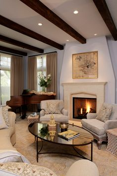Exquisite Fireplace Mantel Ideas Must Haves: Eclectic Living Room With Beams Ceiling And Oval Glass Top Coffee Table Transitional Fireplace Mantel Ideas And Elegant Piano ~ SFXit Design Furniture Inspiration