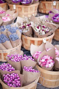 Flowers in paper in baskets = <3