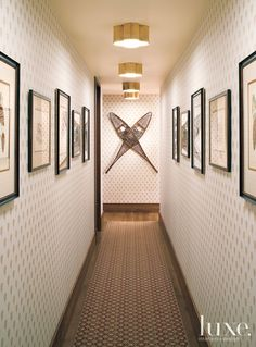 Light fixtures from Visual Comfort & Co. illuminate wallpaper from Sister Parish Design and a Patterson, Flynn & Martin rug in a hallway. Antique snowshoes adorn the space as do prints from Lo Forti Fine Prints in San Anselmo, California. Decor, Luxe Interiors, Hallway Decorating, Interior, Cabin Decor, Cabin Interiors, Cottage Decor, Ski Decor, Interior Design