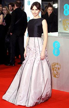 The Theory of Everything star and Leading Actress nominee looked ladylike in a Christian Dior navy and lilac gown with floral embellishments.