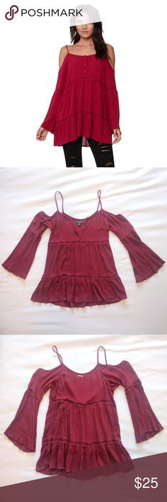 Kendall & Kylie maroon cold shoulder bell sleeves This super cute Kendall & Kylie cold shoulder top has long bell sleeves. Maroon color. Front has three buttons in front that are intact. In great condition. No rips, stains, or tears. Kendall & Kylie Tops Blouses