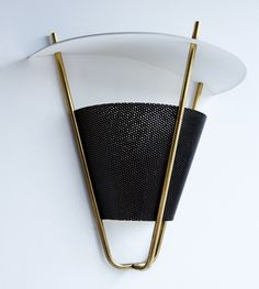 Gerald Thurston; Brass, Painted and Perforated Metal Sconce for Lightolier, 1950s.