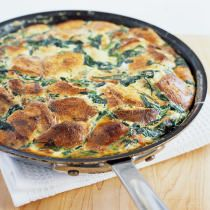 In its most basic form, a strata is a layered casserole of bread, cheese, and creamy eggs—in essence, a savory bread pudding. Typically, stratas must be prepared hours in advance to allow the bread to absorb the custard. Can you attain the same creamy, substantial texture without the wait?
