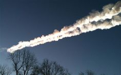 A meteor contrail is seen while fragments of the meteor fall in the Chelyabinsk regionof Russia - Picture: ITAR-TASS / Barcroft Media