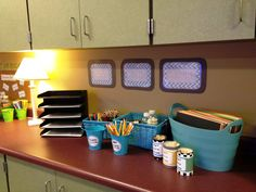 Counter organization. I like the colored paper storage.