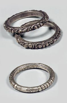 China | Three bangles from the Miao people; two with fish, frogs and flower motifs. | Silver