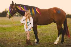 Horse with rainbow mane and hand prints all it takes is mane color and some body paint avalible at jeffers