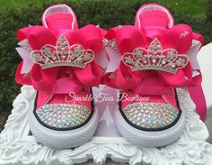 { SPARKLE TOES } WHERE EVERY PRINCESS DESERVES A LITTLE SPARKLE IN HER STEP! ♥ Imagine the look on your little ones face when she opens these remarkably sparkly shoes fit for a princess! They are fabulous for birthdays, baby showers, christmas presents, or with halloween costumes! Adorable with leggings, tutus, and pettis! ♥ Pink Converse shoes. Shoes are available in hi tops or low tops and come embellished with crystals and ribbon laces. Bows are attached to french clips for extra…