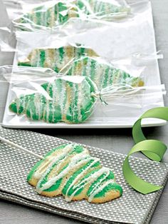 "Cream Cheese and Orange Essence Christmas Trees - Green-tinted dough is piped into tree shapes and then baked to make these holiday cookies. A light glaze and white sugar crystals add a little ""snow"" on top."