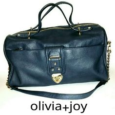 Navy Blue PVC Leather Look Turn Lock Duffle Purse Every woman needs that go-to, any-time, carry-all, goes-with-anything type of purse and THIS IS IT! The longer strap is removable but also looks super chic hanging down even if you wear it as a handbag, so it gives you options, and the cool, relaxed style of it makes it perfect for everyday use! I've used it but there are zero flaws. Olivia + Joy Bags Satchels
