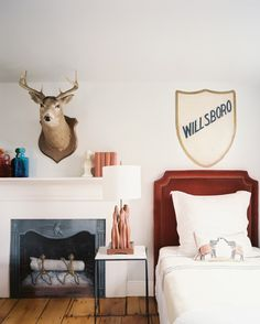 Bedroom Photo - A twin bed beside a fireplace with a white mantel