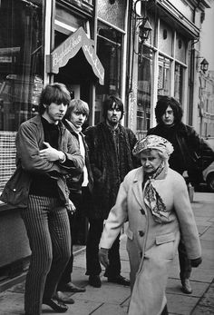 The Yardbirds photographed by Linda McCartney, London, 1968....I'd forgotten Jimmy Page (Led Zeppelin) was part of the Yardbirds! (Lol, they look slightly menacing here towards that old lady)