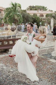 Elegant Dominican Republic Destination Wedding, Bride and Groom Reception Entrance | Brides.com