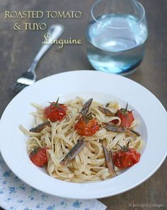 ROASTED TOMATO & TUYO LINGUINE == 20 pcs cherry tomatoes 500g Linguine pasta, cooked according to package directions 20 pcs tuyo fillets {dried salted herring} and the oil that it came with{I used bottled tuyo fillets in olive oil} ½ cup olive oil 6 cloves garlic, minced salt and pepper to taste  ====