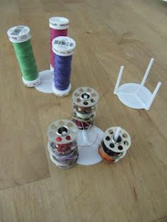 "Use Upcycled ""Pizza Tables"" to Organize Bobbins and Spools of Thread."