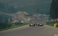 1962, XXII Grand Prix de Belgique. Spa Francorchamps. The cars climbs the Kemmel to Les Combes. Jim Clark and Trevor Taylor