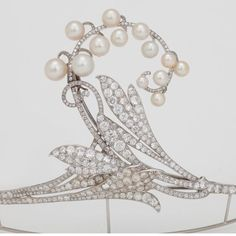 The diamond and button pearl tiara. This piece is reminiscient of a sprig of Lily of the Valley, with diamond leaves and pearls in place of the petite flower-heads