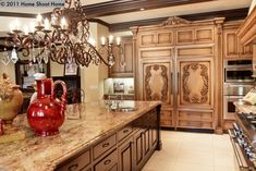 Inside Mediterranean Homes | Who knew that a refrigerator could be hidden behind wood carved doors ...
