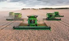 Image result for John Deere Combines working on farm