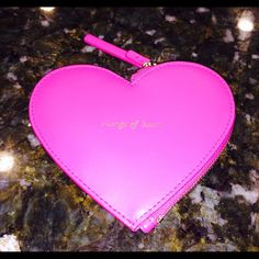 """Kate Spade heart coin purse NWT Super cute Kate Spade Heart Coin Purse in Sweetheart Pink. Gold lettering """"change of heart"""" on one side and Kate Spade on the other. Zip closure on one side. Approximately 5"""" across at widest point and 3.75"""" down the center. NWT NEVER USED.  NO TRADES kate spade Bags"""
