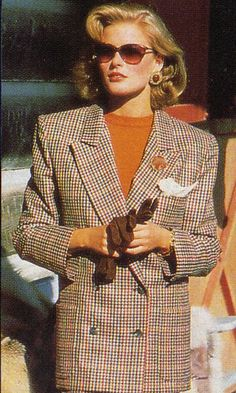 I had a unpatterned, camel coloured, wool blazer with gold buttons, this style - KJ