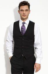 classy + vest, and a purple tie. Striking
