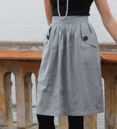 Kindling – 'Kind of Blue' skirt featuring deep pockets made from grey-blue linen-silk slub. This skirt is so nice, easy to wear in Summer or with tights in winter. Featuring a lovely buttons and pocket details. • See more at The Big Design Market on 6/7/8 December 2013 – Royal Exhibition Building, Melbourne.  www.thebigdesignmarket.com