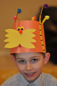 This Lorax hat is just adorable. Instead of paper Truffula Trees, we are using pipe cleaners.