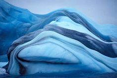 "Norwegian sailor Oyvind Tangen, 63, captured nature at its most mysterious and beautiful while on board a research ship 660 miles north of the Antarctic. His stunning photographs of brilliantly colored icebergs, remind Tangen of,  ""…striped candy I bought as a child."" His images remind us of nature's eye-candy, which is now forever documented as a testament to the majestic beauty that unfolds on our planet."