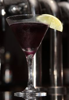 Gin Sin Martini | Gin, peach schnapps, blue curacao and cranberry juice