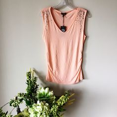 Vince Camuto Sleeveless Peach Top Crystal studs at each shoulder, gathered at each side towards the hem, 96% rayon / 4% spandex. Vince Camuto Tops Blouses