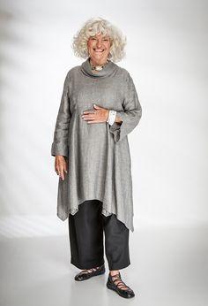 Roll Neck Tunic in Kernan linen £265 (Steel Smoke) over New Width Trousers £225 (Black Wool).