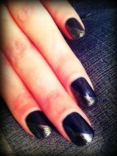 Shellac nail art shimmery dark blue with gold sparkle sideways over half.