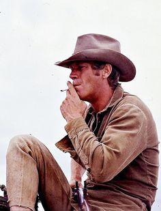 Steve McQueen  Sucker for a fella in a cowboy hat.