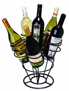 Beautiful harmony of form and function, this Oenophilia Bottle Bouquet Wine Rack holds 6 bottles and makes a wonderful display on the table, countertop, or bar. Made of metal with a handsome black finish, this rack is designed to hold the bottles eit Gifts For Wine Lovers, Wine Gifts, Traditional Anniversary Gifts, Wine Decor, Wine Collection, Wine Refrigerator, Wine Fridge, Wine Bottle Holders, Wine Bottles
