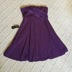 Beautiful Ann Taylor swing dress Perfect for many occasions! Deep purple knee length with lots of flare. Polyester & spandex make this comfortable as well as classy. Size 14   Brand new with tags. 2nd picture is true color. Ann Taylor Dresses Strapless