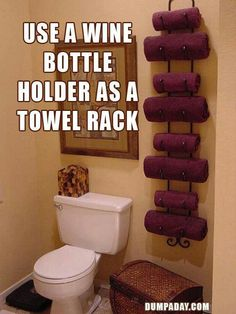 Great idea....wine rack as towel rack!