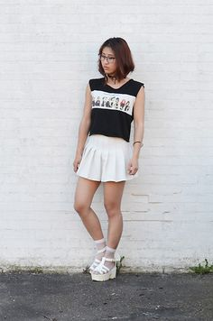 Get this look: http://lb.nu/look/8330987  More looks by RuiJun L: http://lb.nu/ruijunluong  Items in this look:  Ace And Tate Black Glasses, Shop Chokers Chokers Black, Ebay Simpsons Top, Ebay Pleated Skater Skirt, Moretights Socks Mesh White, Newdress White Platform Sandals   #casual #edgy #minimal