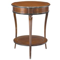 French Heritage - Amelie Round Gueridon Romance:    With its distinctive, discreet lines this occasional round table makes an elegant addition between club chairs. Its old-world antique style artistry and classical proportions make it a timeless addition wherever it is placed!    SPECIFICATIONSMEASUREMENTS  Dimensions (LxWxH):23x23x28  Weight (lbs):85  Volume (cubes):0.247  MATERIALSFINISH  CherryAntique Cherry With Black Trim Finish
