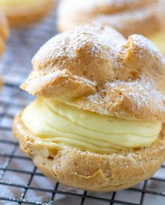 My famous easy authentic Homemade Cream Puffs recipe light and airy cream puffs filled with vanilla pudding cream are always a hit with family and anyone Ive served them. Köstliche Desserts, Delicious Desserts, Dessert Recipes, Instant Pudding, Cream Puff Filling, Easy Cream Puff Recipe, Custard Cream Puffs Recipe, Mini Cream Puffs Recipe, Cream Puff Dessert