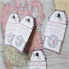 escort card tags can be used countless ways, whether tied to a guest gift... or maybe an old-fashioned soda to sip on their arrival... or how about tacked to a framed vintage map? We can provide them blank for you to write in, or print all of your table assignments for an additional charge. Email us for details on the customized option.