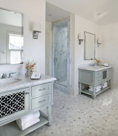 Sophisticated master bathroom features polished nickel mirrors over blue vanities with laser cut doors and turned legs topped with white marble countertops atop calacatta michaelangelo marble floor flanking doorway to walk-in shower and water closet. Bathroom Spa, Modern Bathroom, Bathroom Ideas, Bathroom Vanities, Bath Ideas, Bathroom Designs, Bathroom Renovations, Waterworks Bathroom, Bathroom Remodelling